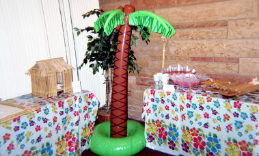 Gift table and punch table at luau reception