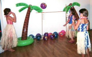 Girls playing with beach balls at reception