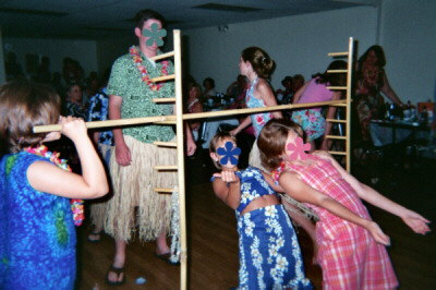 Playing limbo at Hawaiian Luau.